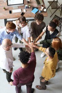 team gathering hands in